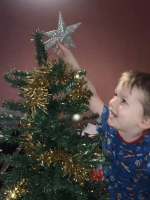 134. My little grandson Declan is so excited to put the star on his tree