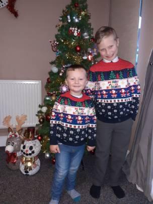 My boys wearing Xmas jumpers for last day of school & nursery