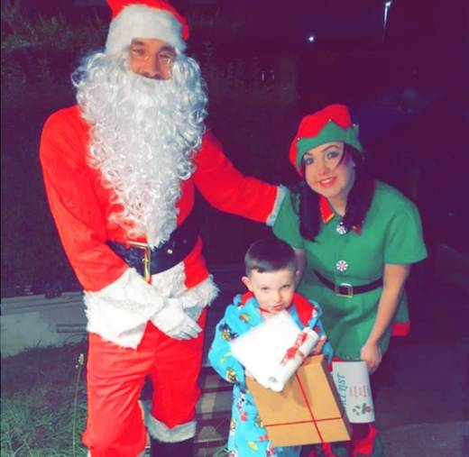 Main image for Youngsters on the good list getting rewarded by Santa