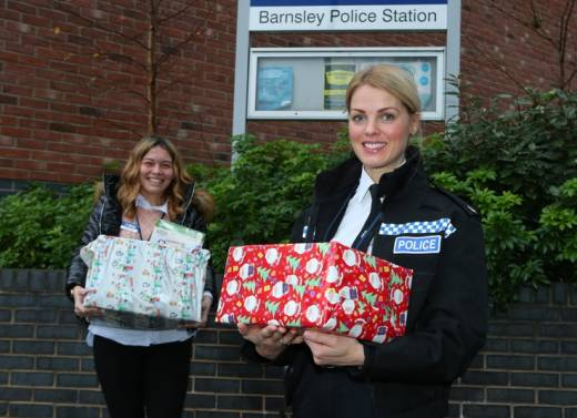 Main image for Police help spread Christmas cheer with food hampers