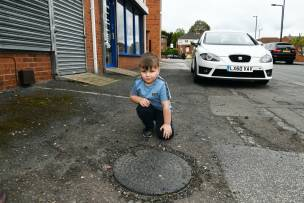Main image for Youngster left shook up by fall into manhole