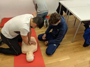 Students learning how to perform CPR