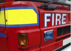Main image for Couple pulled from flat fire
